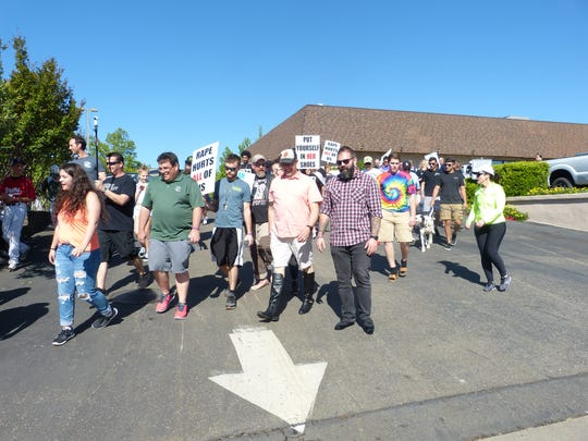 Men and women wear heels and march along Hilltop Drive on Saturday morning for One SAFE Place's Walk a Mile in Her Shoes event.