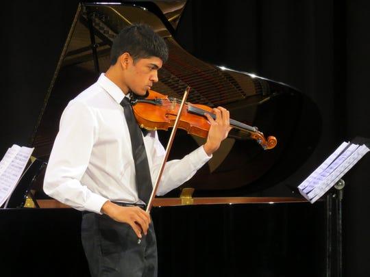 Wardlaw+Hartridge senior Suraj Chandran of Edison plays violin at the recital.