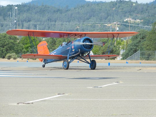 One of three Stearman Speedmail biplanes lands Wednesday at Benton Airpark in Redding