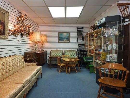 Katrina's Vintage Shop, 1218 Milwaukee Ave., opened in May in the former Green Flag Racing storefront. The store features furniture and vintage toys among other items.
