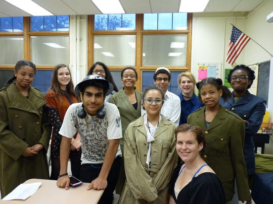 North Plainfield Middle School student with reenactor Vivian Davis, bottom right, at the 2018 North Plainfield Middle School Holocaust exhibit.