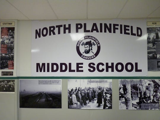 North Plainfield Middle School's banner surrounded by World War II era images during the 2018 Holocaust exhibit at the school.