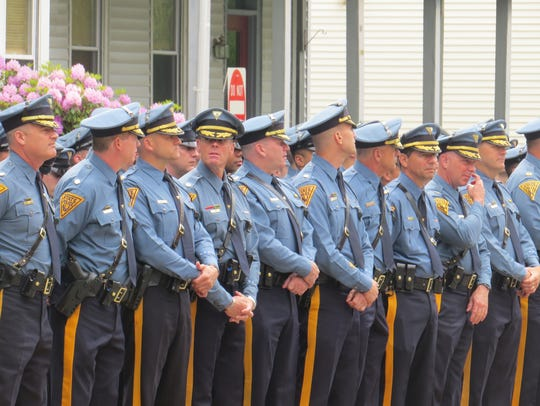 New Jersey State Troopers stand guard at funeral for