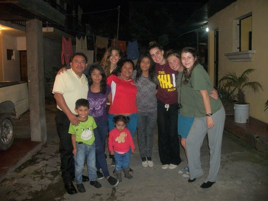 Eliana Pritchett, a Poudre High School senior, went on the service trip last year. She stayed with her host family and a couple other students, pictured here.