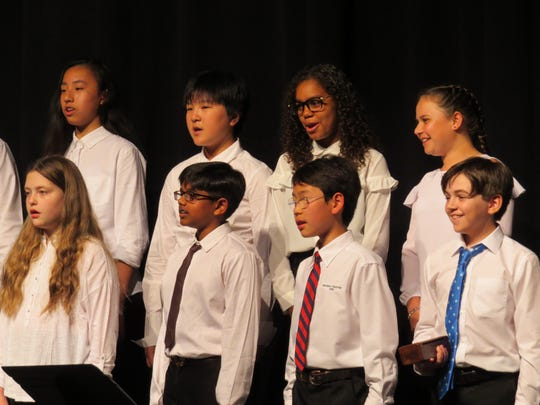 The sixth grade choir performs at the concert.