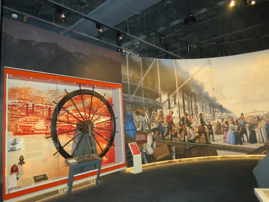 A gallery at the new Museum of the Gateway Arch depicts
