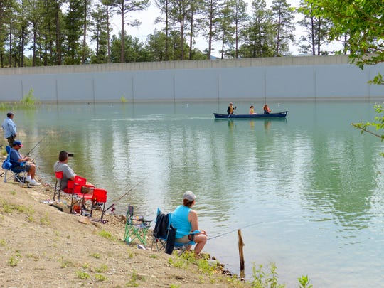 Small boats with electric motors are allowed this summer at Grindstone Lake in Ruidoso. Canoes and kayaks already are paddled around the fishing reservoir.