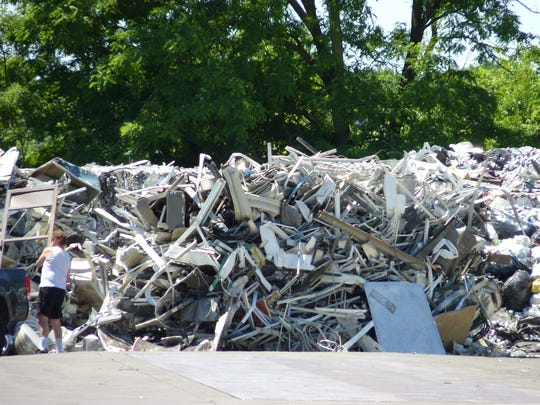 A man recycling metal at Federal Metals and Alloys in South Plainfield.