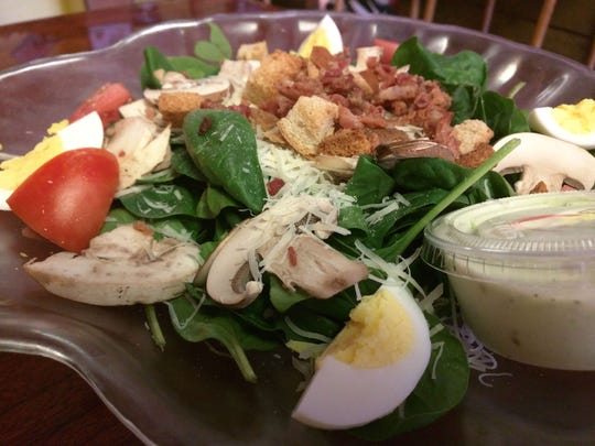 Barefoot Cafe's spinach salad was overflowing with bacon, tomatoes, hard boiled eggs, mushrooms, croutons, and fresh Parmesan cheese.  Here it was accompanied by cusabi dressing, a blend of cucumber and wasabi.