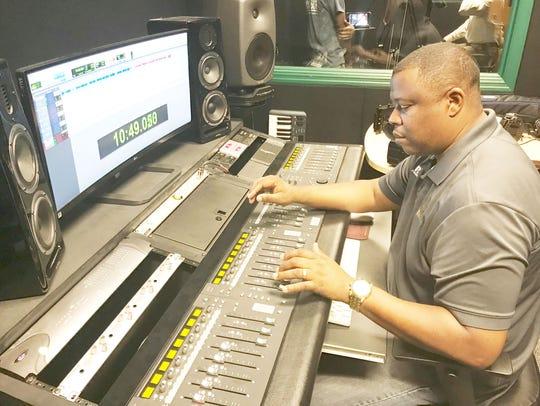 FAMU sports information director, Vaughn Wilson, works