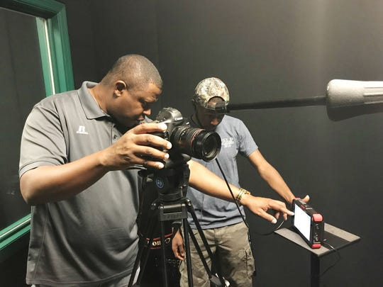 Vaughn Wilson, left, goes over footage with Kimani Flemming during a recording session.