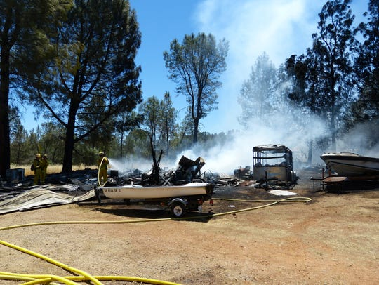 A garage at a Happy Valley residence burned down in