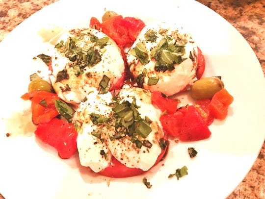 Ruffino's Mozzarella Caprese with bright, red tomatoes,