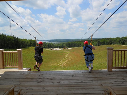One thing you can do on a Lake Geneva canopy tour is