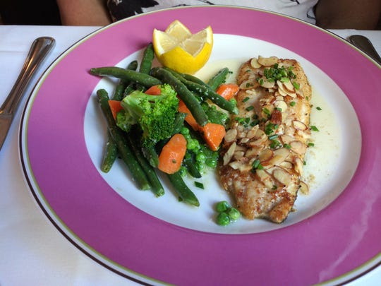 Filet de truite was a portion of seared fish with sautéed green beans and toasted almonds, finished in a warm, buttery herbed sauce, beurre noisette.