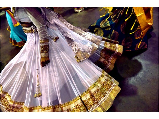 Dresses swirl and spin during the Garba on July 6, 2018, in the Round Building at the Taylor County Expo Center. The circular, rhythmic dance is said to reflect the Hindu understanding of time. Upasna and Amit Bhakta were married the following day.