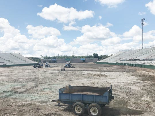 A view from the end zone facing the fieldhouse. The grass is finally removed from the stadium.
