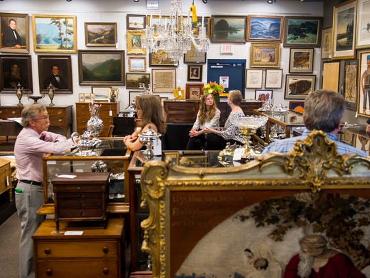 Guests browse antiques on display at Case Antiques.