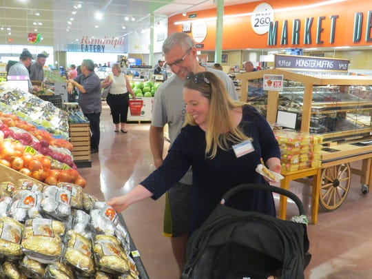 Amy Rosenthal-Laffey of Randolph shops with her husband, Patrick Laffey, and their daughter, Taylor, in the new Weis Market grocery store, which opened July 18, 2018 in the space of a former A&P store.