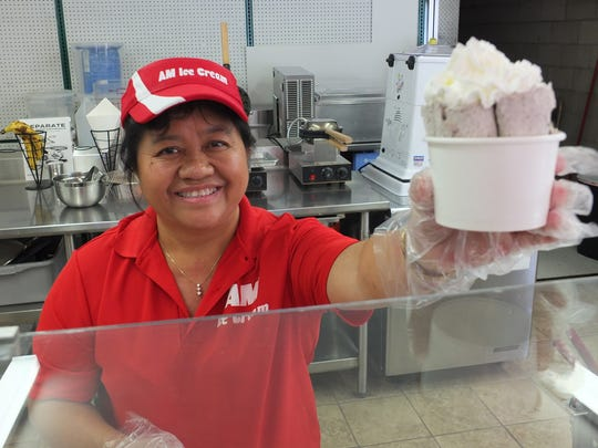 The owner of AM Ice Cream, Lee C. Yang, displays a cup of rolled Oreo ice cream. AM Ice Cream offers a number of flavors including fudge mint and Fruity Pebble ice cream.