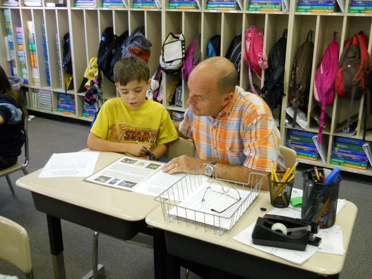Jim Griffin works with a former student named Robert in his classroom at Black Mountain Elementary School. Griffin celebrates his retirement on July 29 at Lake Tomahawk.