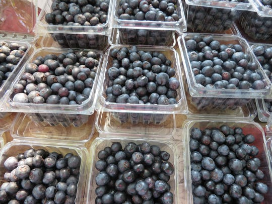 The silvery haze on fresh blueberries acts as a natural