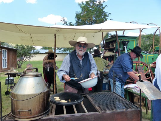 A participant cooks up some grub frontier style.