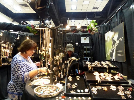 Lisa Carlson's creative jewelry was selling at a brisk