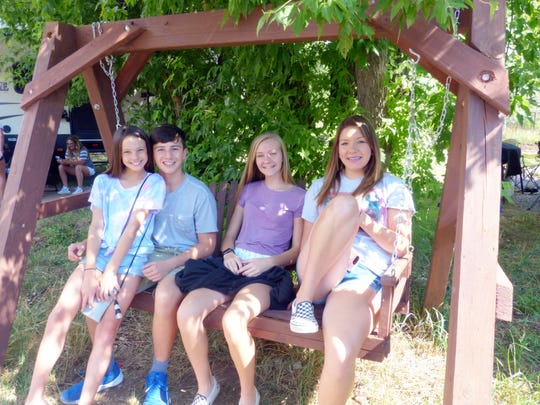 Some of the next generation of the White family enjoyed a ride on a communal swing.