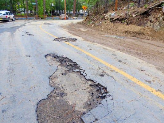 chunks of pavement torn away
