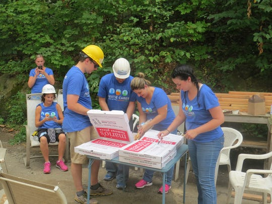 Employees of the Nestle Health Science Division in Bridgewater take a lunch break while helping to build a Habitat for Humanity house in Dover as part of the company's national day of service. August 2, 2018.