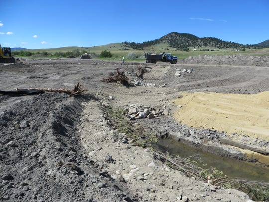 Construction of a new stream channel occurs on Sevenmile Creek, a tributary of Tenmile Creek flowing through the Helena Valley to Hauser Reservoir, which is owned and operated by NorthWestern Energy.