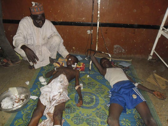 Students are treated at the hospital in Potiskum, Nigeria,