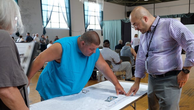 Resident Randy Owens, left, and Hussein Ibrahim from MDOT, right, discuss impact on Interstate 75 construction.