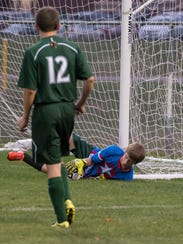 Pennfield's goalkeeper Keith Browand makes a stop during