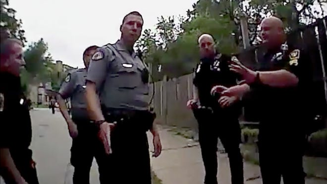 "The moment when Tensing, center,  is talking with CPD officers and Kidd says ""I saw it"" referencing the shooting. This is from what was given to us a Phillip Kidd's body camera."