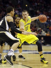 Michigan guard Nik Stauskas. He averaged 17.5 points