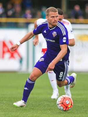 Louisville City FC's  Guy Abend drives the ball up the field in the second half in Saturday's match. Louisville lost 2-0.