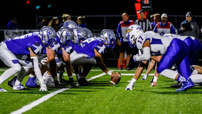 Waukesha West faces off against Germantown during the game at West on Thursday, Sept. 7, 2017.