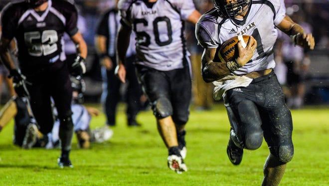 Kaplan running back Julius Johnson (11) runs for a touchdown during an LHSAA football game at Vermilion Catholic High School Friday, Sept. 11, 2015.