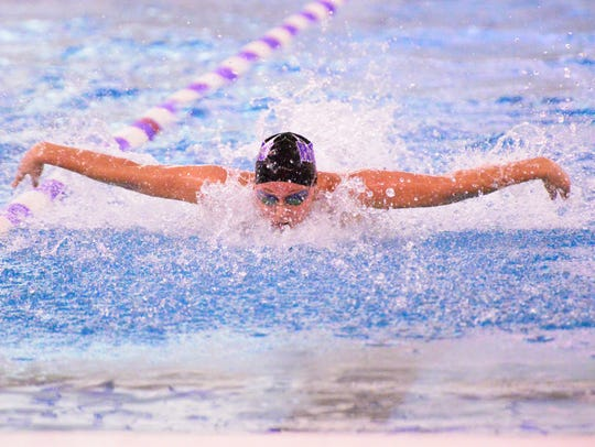AnneMarie Moses of Fremont Ross competes in the 100 butterfly Saturday.
