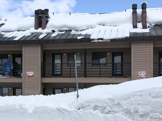 A snow laden rooftop is seen on lodging at Kirkwood