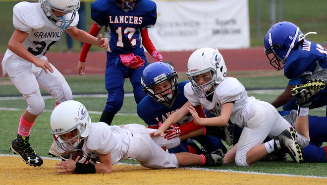 Beckett Longof Granville makes it into the end zone on a PAT run cinching the championship win for Granville over Lakewood with just seconds left in the game. The final score was 13-12.