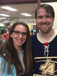 Our Lady of Sorrows parishioners Alan LaTour and his wife Alena are all smiles after Friday's 3-2 victory over Sacred Heart Major Seminary. LaTour scored the game-winning goal.
