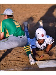 Hawley's Robert Ybarra dives back to first base as New Deal first baseman Kyler Reed catches the ball Thursday.