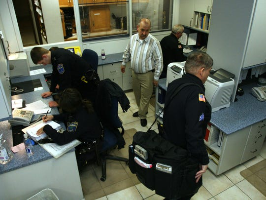 This file photo shows the crowded officer work space