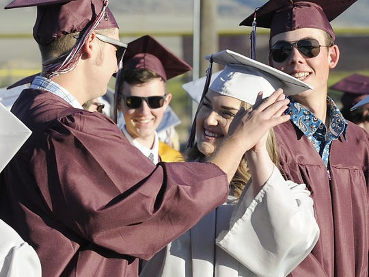 Jacob Reeves and Taylor Furr high-five each other before the start of the ceremony.