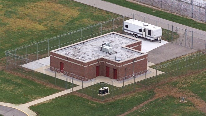 In this June 11, 2001 file photo, an aerial view of the execution facility at the United States Penitentiary in Terre Haute, Ind., is shown. After the latest 17-year hiatus, the Trump administration wants to restart federal executions this month at the Terre Haute, prison. Four men are slated to die. All are accused of murdering children in cases out of Arkansas, Kansas Iowa and Missouri.