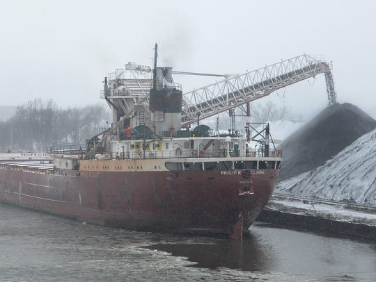 The lakes carrier Philip R. Clarke unloads coal at