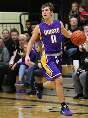 Unioto's Brandon Kennedy brings the ball up the floor against Miami Trace earlier this month. Kennedy's Shermans were awarded a No. 2 seed in the Division II sectional bracket Sunday.
